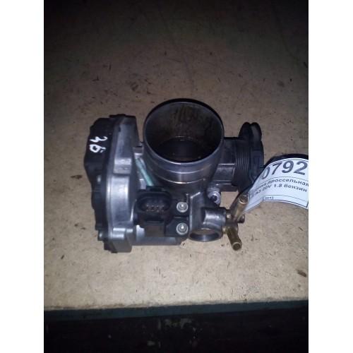 Дроссельная заслонка 1.8 V20 бензин (06A133064M)